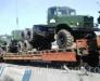Der Schienentransport von Fahrzeugen (LKW, Zugmaschinen, Tankwagen).
