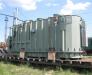 Transport de cargaisons lourds à des wagons spécialisés