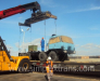 Loading of tractors, trucks, road tankers on the railway cars.
