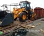 Le transport ferroviaire des machines et de l'équipement de construction et de réparation des routes (pelles, bulldozers, chargeuses, niveleuses, grues, compacteurs, équipements de pavage)